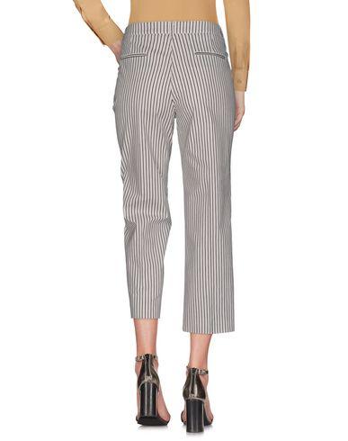 Фото 2 - Повседневные брюки от KILTIE белого цвета