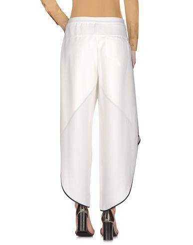 Фото 2 - Повседневные брюки от REVISE белого цвета