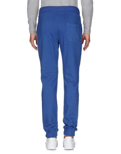 Фото 2 - Повседневные брюки от ASPESI синего цвета