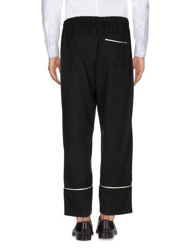 Фото 2 - Повседневные брюки от LANEUS черного цвета