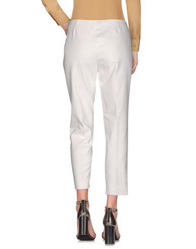 Фото 2 - Повседневные брюки от CLIPS MORE белого цвета