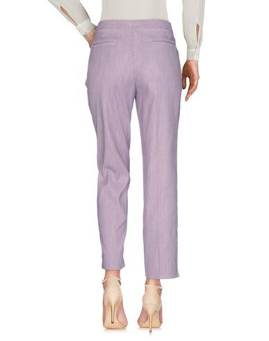 Фото 2 - Повседневные брюки фиолетового цвета
