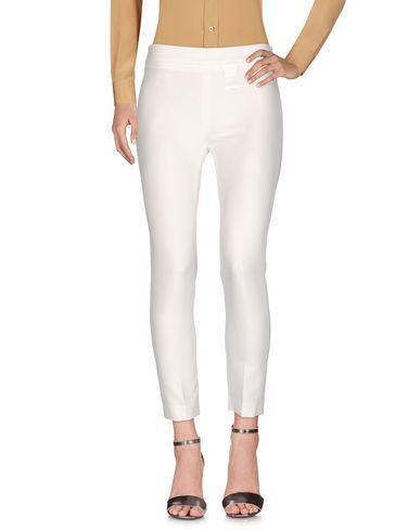 Фото - Повседневные брюки от REVISE белого цвета