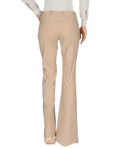 Фото 2 - Повседневные брюки от QL2  QUELLEDUE бежевого цвета