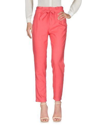 Фото - Повседневные брюки от SUNCOO кораллового цвета