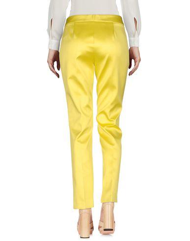 Фото 2 - Повседневные брюки от CHRISTIAN PELLIZZARI желтого цвета