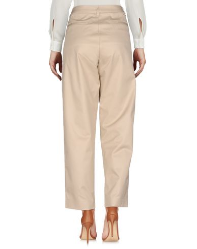Фото 2 - Повседневные брюки от COVERT бежевого цвета