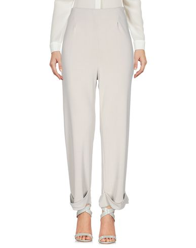 Фото - Повседневные брюки от MAISON LAVINIATURRA светло-серого цвета