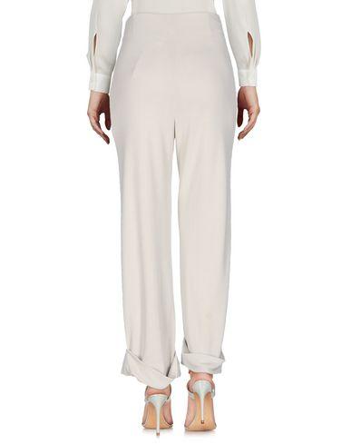 Фото 2 - Повседневные брюки от MAISON LAVINIATURRA светло-серого цвета