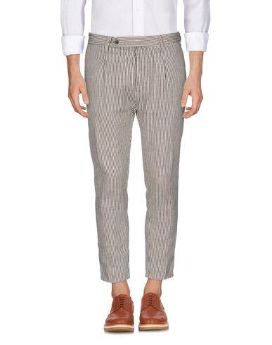 Фото - Повседневные брюки от CRUNA бежевого цвета