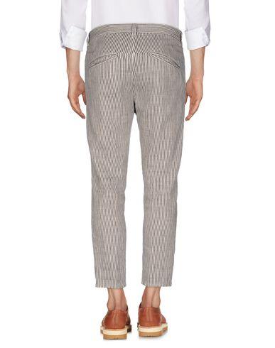 Фото 2 - Повседневные брюки от CRUNA бежевого цвета