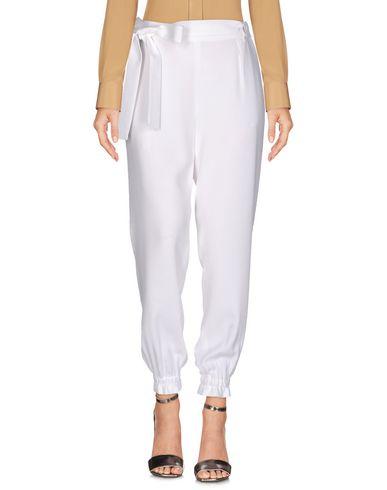 Фото - Повседневные брюки от MSGM белого цвета