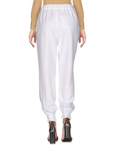 Фото 2 - Повседневные брюки от MSGM белого цвета
