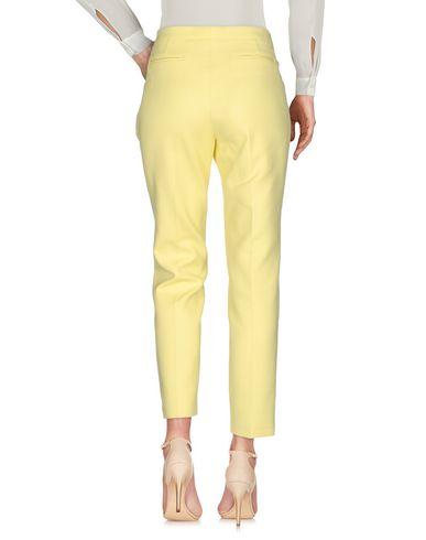 Фото 2 - Повседневные брюки от FABIANA FILIPPI желтого цвета