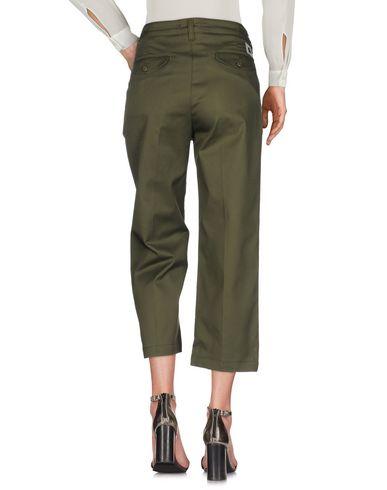 Фото 2 - Повседневные брюки от CARHARTT цвет зеленый-милитари