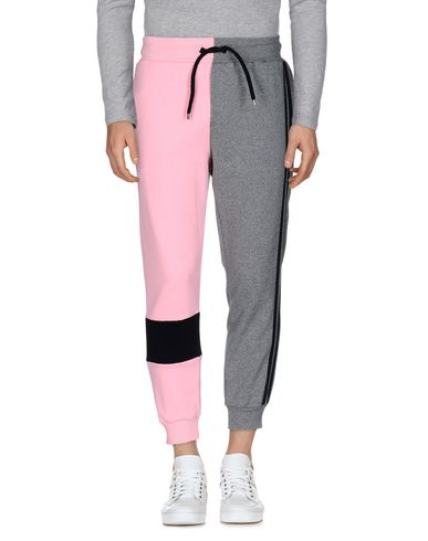 Купить Повседневные брюки от MNML COUTURE серого цвета