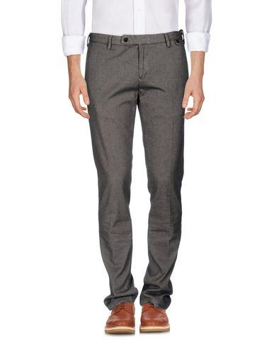 Фото - Повседневные брюки от AT.P.CO бежевого цвета