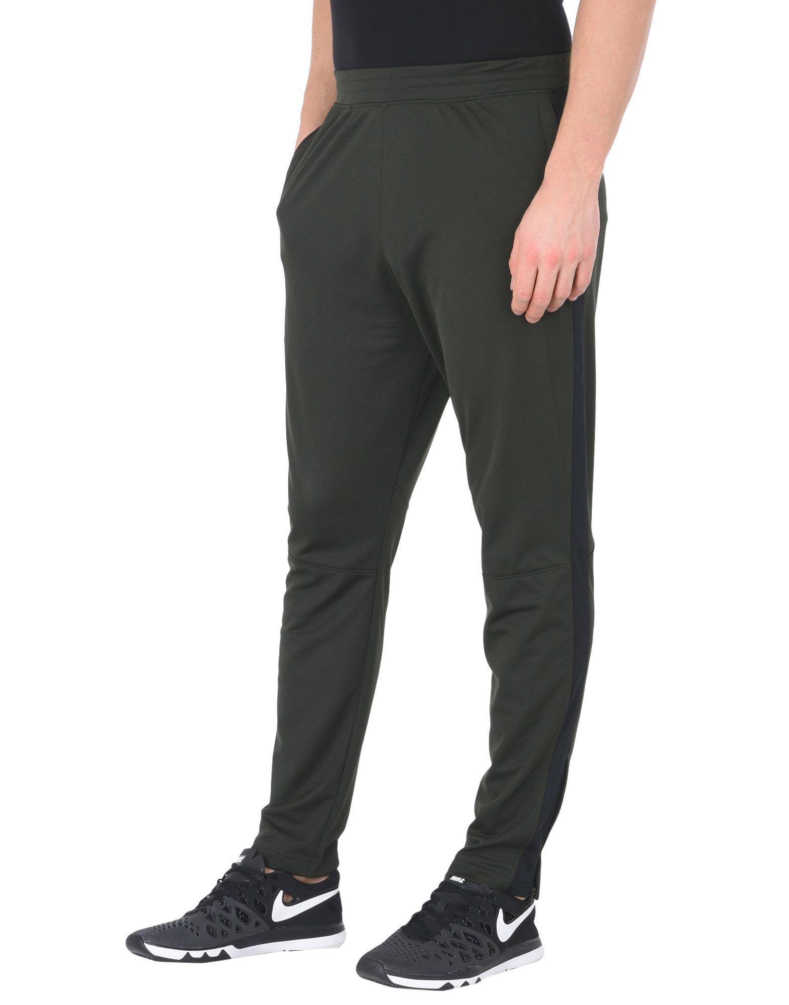 цена UNDER ARMOUR Повседневные брюки онлайн в 2017 году