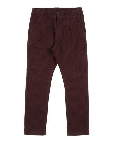 Фото - Повседневные брюки от QUICK BEING красно-коричневого цвета