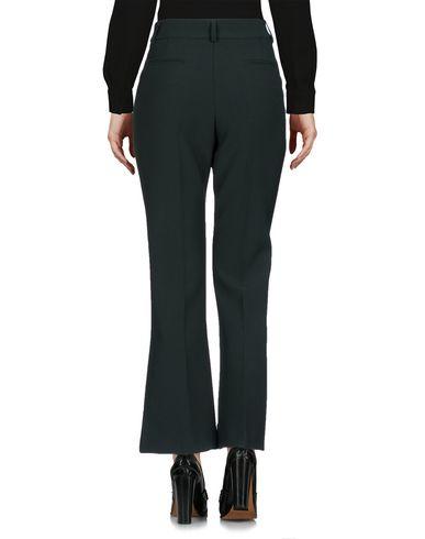 белым фото женских брюк темно зеленого цвета вот для деловой