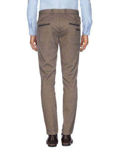 Фото 2 - Повседневные брюки от KOON темно-коричневого цвета