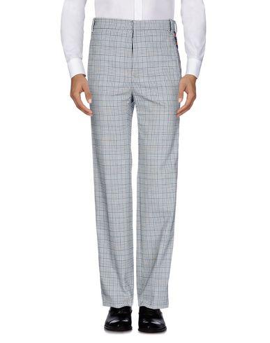 Фото - Повседневные брюки от KAPPA x FAITH CONNEXION серого цвета