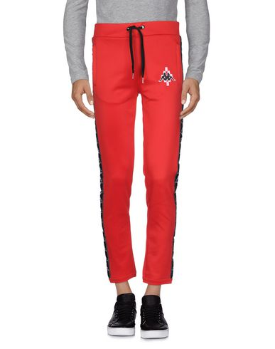 Фото - Повседневные брюки от MARCELO BURLON x KAPPA красного цвета