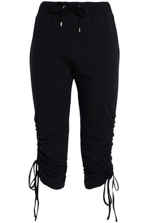 MOSCHINO Cropped French cotton-blend terry track pants