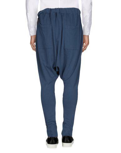 Фото 2 - Повседневные брюки от BAD SPIRIT темно-синего цвета