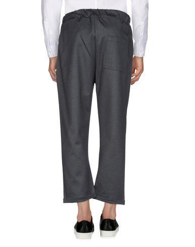 Фото 2 - Повседневные брюки от MADD черного цвета