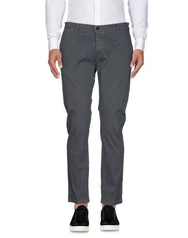 Фото - Повседневные брюки от ADDICTION серого цвета
