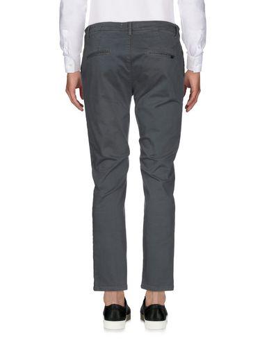 Фото 2 - Повседневные брюки от ADDICTION серого цвета