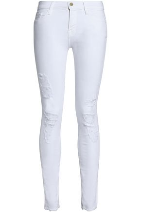 FRAME Distressed low-rise skinny jeans