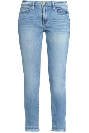 FRAME Frayed faded low-rise skinny jeans