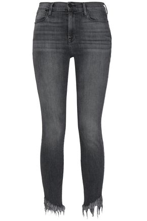 FRAME Frayed mid-rise skinny jeans