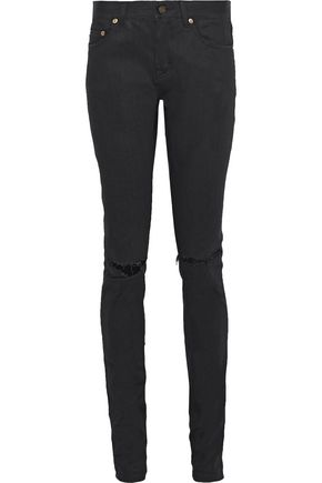 SAINT LAURENT Distressed coated mid-rise skinny jeans