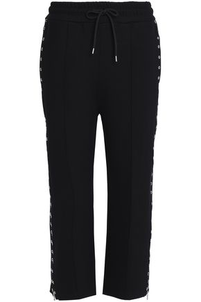 McQ Alexander McQueen Eyelet-embellished stretch-jersey straight-leg pants