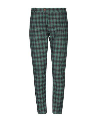 Фото - Повседневные брюки от NEILL KATTER зеленого цвета