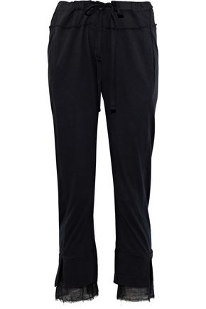 ANN DEMEULEMEESTER Cropped frayed cotton-jersey slim-leg pants