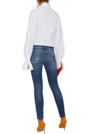 DOLCE & GABBANA Appliquéd distressed low-rise skinny jeans