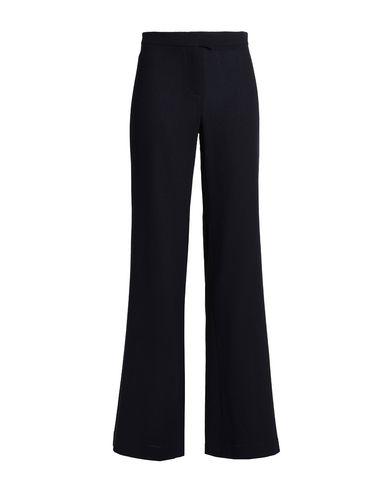 Фото - Повседневные брюки от GOAT темно-синего цвета