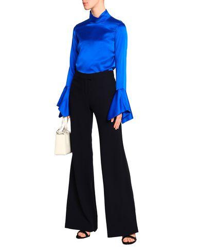Фото 2 - Повседневные брюки от GOAT темно-синего цвета