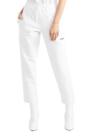 VETEMENTS Embroidered French stretch-cotton terry straight-leg pants