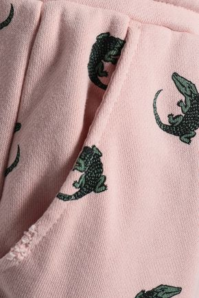 ZOE KARSSEN Distressed printed cotton-blend tapered pants