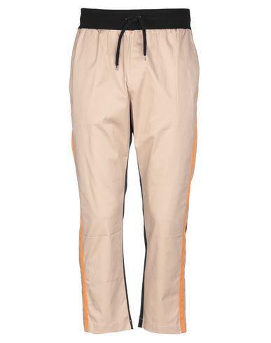 Купить Повседневные брюки от MNML COUTURE бежевого цвета