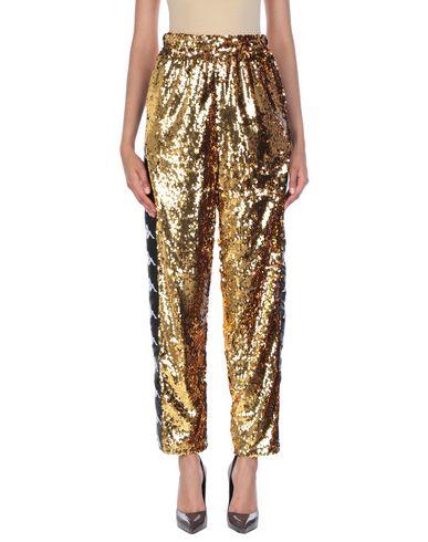 Фото - Повседневные брюки от KAPPA x FAITH CONNEXION золотистого цвета