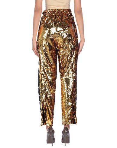 Фото 2 - Повседневные брюки от KAPPA x FAITH CONNEXION золотистого цвета