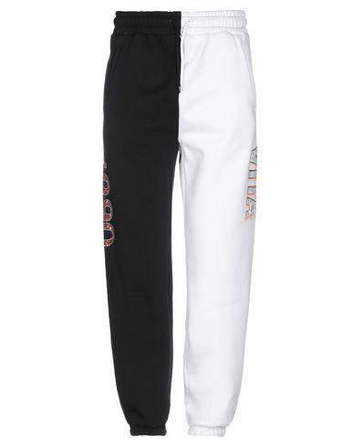 Фото - Повседневные брюки от GRMY белого цвета