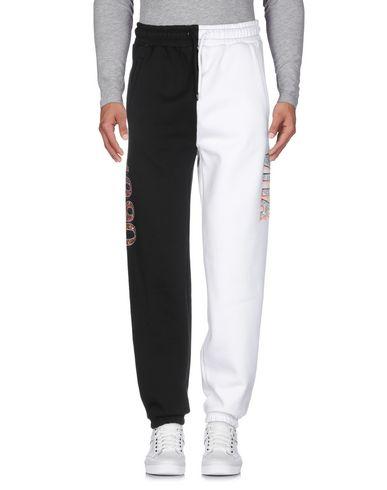Фото 2 - Повседневные брюки от GRMY белого цвета