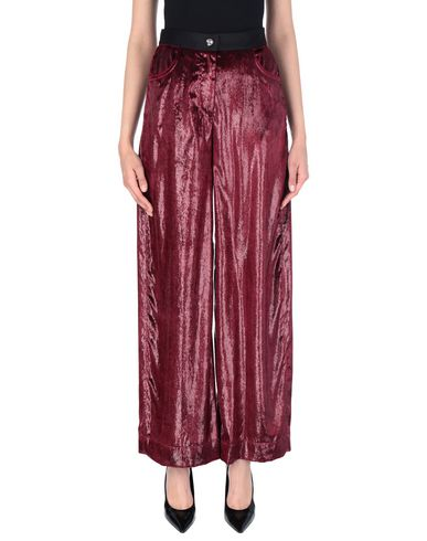 Фото - Повседневные брюки красно-коричневого цвета